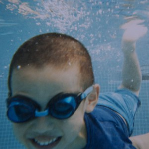 A boy diving, with a smile